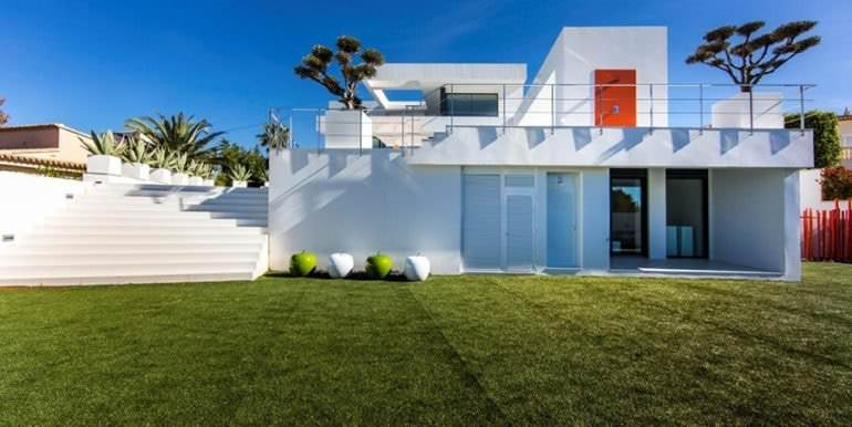 New villa in minimalist style with sea views in Moraira El Portet - Garden and side view - ID: 5500633 - Photographer: Michael van Oosten