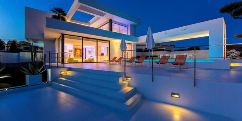 New villa in minimalist style with sea views in Moraira El Portet - Pool terrace illuminated - ID: 5500633 - Photographer: Michael van Oosten