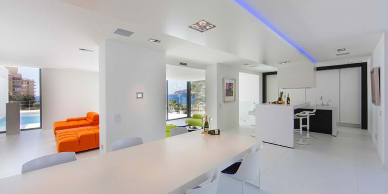 New villa in minimalist style with sea views in Moraira El Portet - Dining area and american kitchen - ID: 5500633 - Photographer: Michael van Oosten