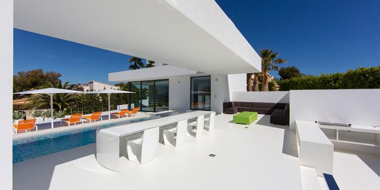 New villa in minimalist style with sea views in Moraira El Portet - BBQ dining area pool terrace - ID: 5500633 - Photographer: Michael van Oosten