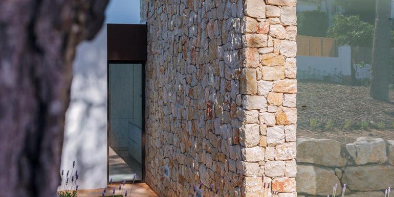 Modern design luxury villa in Moraira Moravit - Facade and natural stone wall - ID: 5500684 - Architect Ramón Esteve Estudio