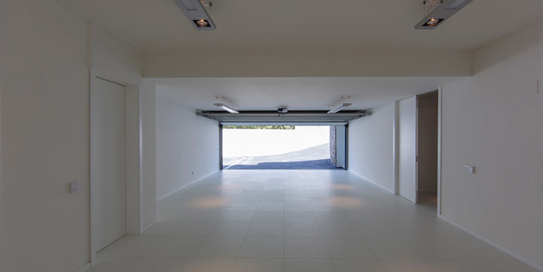 New villa in minimalist style with sea views in Moraira El Portet - Garage - ID: 5500663 - Architect Carlos Gilardi (Equipo Digitalarq S.L.) - Photographer Michael van Oosten - Villa CAWOW