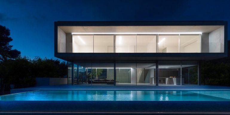 New build design villa with sea views in Moraira El Portet - Pool terrace and villa illuminated - ID: 5500692 - Architect Dalia Alba